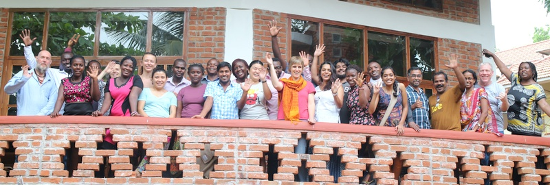 2015 participants along with catalysts waving hands from the balcony of our auditorium