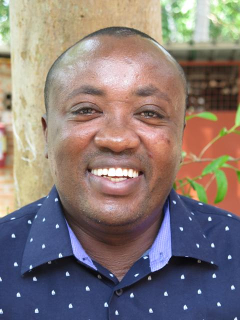 Smiling picture of John Mwangi