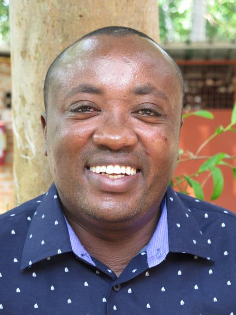 Smiling picture of John Mwangi