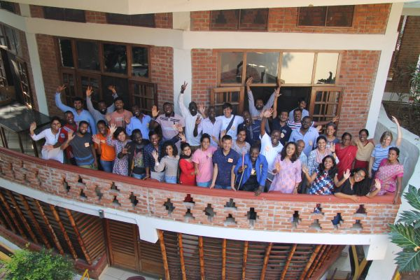 kanthari participants on balcony of the auditorium