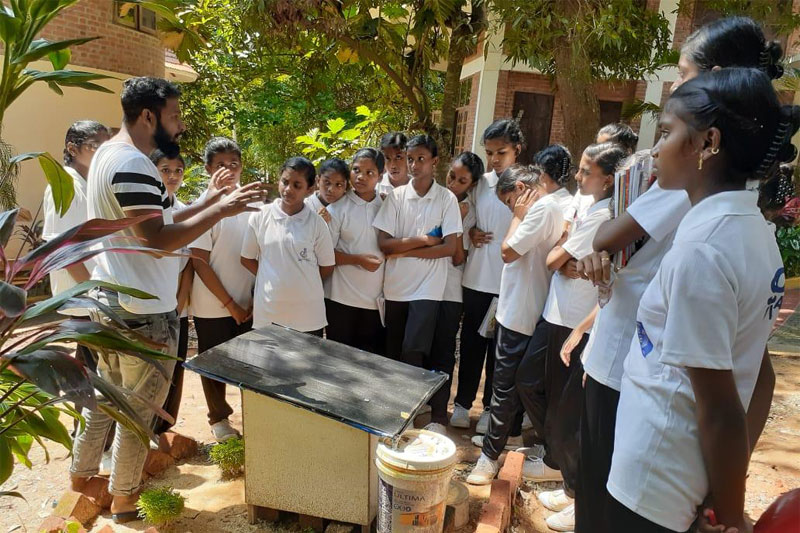 one of the participants explaining water harvesting to the students from a local school at kanthari campus during water week day